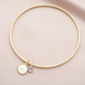 gold plated bangle with beaded edge disc charm and birthstone