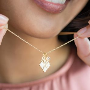 champagne gold plated scalloped edge charm with mini initial letter and birthstone charm