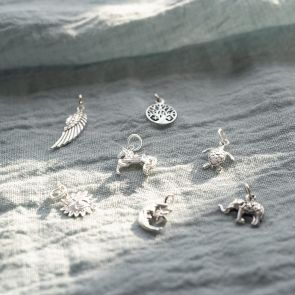 Sterling Silver Charms Available in; Wings, Horse, Sun, Moon, Turtle, Elephant, and Tree Varieties
