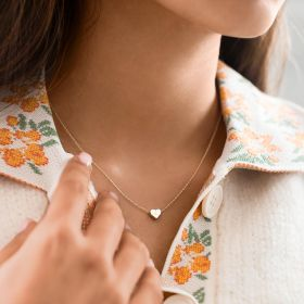 a rose gold dainty heart charm necklace with engraved initial