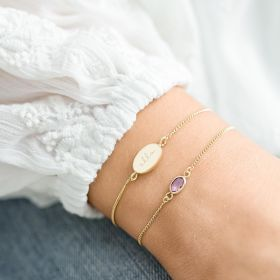 personalised friendship bracelet set with and oval disc charm bracelet and oval birthstone charm bracelet